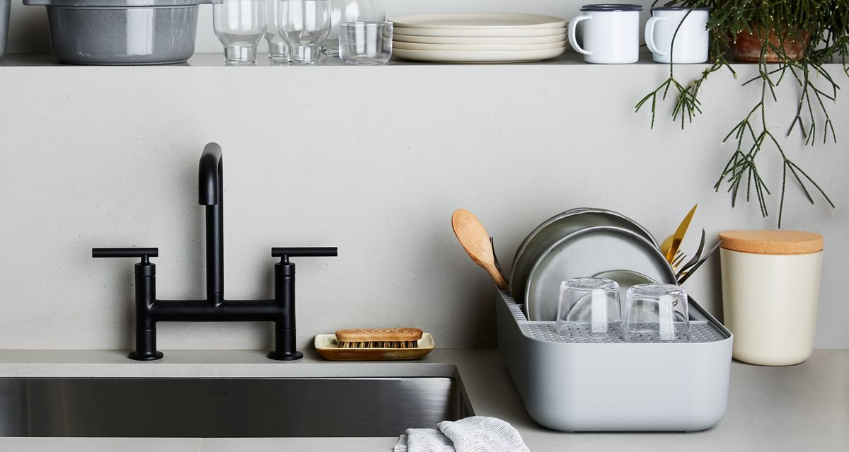small dish rack beside a sink